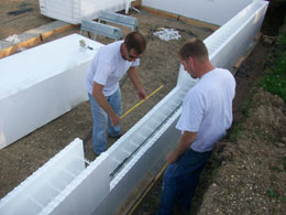 Corey Mennenga & Kirk Schamens of Benchmark Foam install Insulated Concrete Forms (ICF) at Habitat for Humanity site.