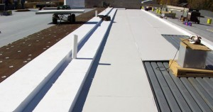 Installation of Benchmark Foam Roofing Insulation