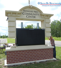 Installing the sign over the Electronic Message Centers