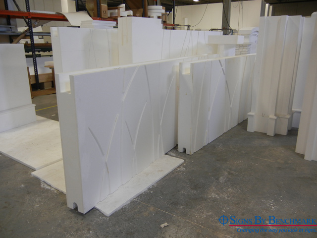 signs by benchmark creating fence posts and panels