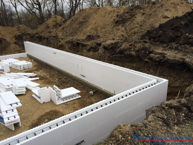 Heavy construction benchmark icf insulated concrete for Foam basement forms