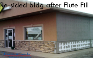 Re-sided steel building after flute fill installation